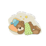 Cute Teddy Bear sleeps on pillow Stock Photo