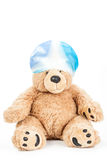 Cute teddy bear with swimming cap. Cute teddy bear with blue swimming cap Stock Images