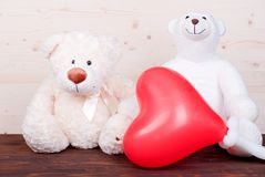 Cute teddy bear toy on the board top view Stock Images