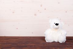 Cute teddy bear toy on the board top view Royalty Free Stock Photography