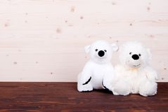 Cute teddy bear toy on the board top view Stock Photography