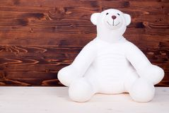 Cute teddy bear toy on the board top view Royalty Free Stock Images