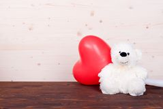 Cute teddy bear toy on the board top view Stock Image
