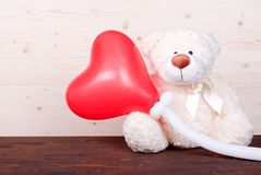 Cute teddy bear toy on the board top view Royalty Free Stock Photo