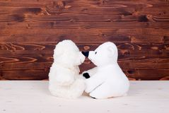 Cute teddy bear toy on the board top view Stock Photos