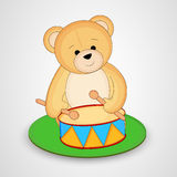 Cute teddy bear toy playing with drum Stock Photo