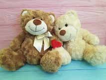 Cute teddy bear toy with red heart romantic on colored wooden. Cute teddy bear toy with red heart colored wooden   lovers day romantic fourteenth of Februar love Stock Photography