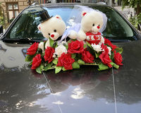 Cute teddy bear wedding ornament on a car Stock Images