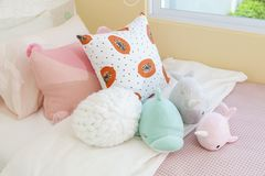 Cute dolls on bed for little girl stock image