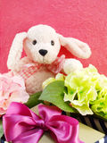 Cute teddy pink bear with gift and beautiful bouquet flower Royalty Free Stock Photo