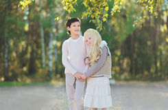 Cute teen boy brunette and beautiful young girl blonde. In nature Royalty Free Stock Images