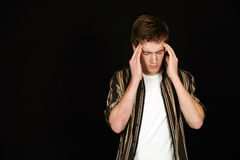 Cute teen boy with headache Stock Photography