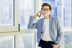 Teen boy with mobile phone. Cute teen boy with mobile phone Stock Photos