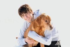 Cute  Teen Boy Smiling with Dog Royalty Free Stock Image