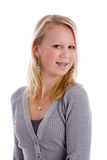 Cute teen with braces. Pretty blond teenage girl with braces smiling Royalty Free Stock Images