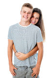 Cute teen couple embracing. Royalty Free Stock Image