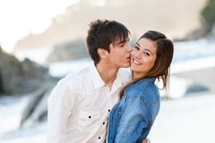 Cute teen couple in love on beach. Close up of handsome teen couple in love on beach Royalty Free Stock Images