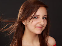 Cute teen girl. Portrait of a cute teen girl, red shirt, black background Stock Images
