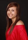 Cute teen girl. Portrait of a cute teen girl, red shirt, black background Stock Photos