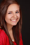 Cute teen girl. Portrait of a cute teen girl, red shirt, black background Royalty Free Stock Images