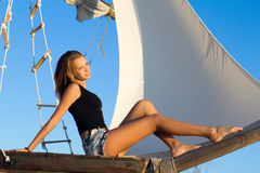 Cute teen girl. Sitting at stern of the ship Stock Photo
