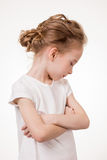 Cute teen girl angry frowns, studio portrait isolated on white background Stock Photo