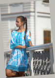 Cute teen girl in blue dress Royalty Free Stock Photography
