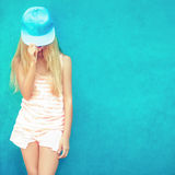 Cute teen girl in blue wall Stock Photo