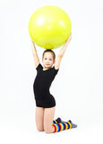 Cute teen girl doing gymnastics exercises with fitness ball Royalty Free Stock Photo