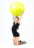 Cute teen girl doing gymnastics exercises with fitness ball Stock Images