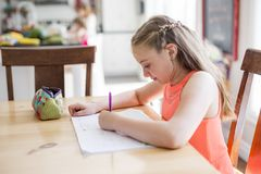 Cute teen girl doing homework at home Royalty Free Stock Photography
