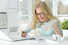 Cute teen girl doing homework Royalty Free Stock Photography