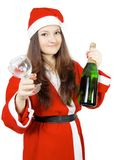 Cute teen girl dressed as Santa with champagne Stock Photos