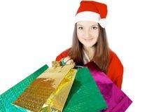 Cute teen girl dressed as Santa with presents Stock Photos