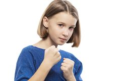 Cute teen girl with fists up close royalty free stock image