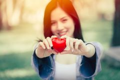 Cute teen girl smiling showing giving heart love concept stock photo