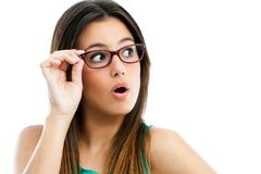 Cute teen girl with glasses looking aside. Stock Image
