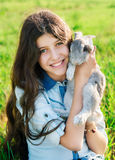 Cute teen girl with gray rabbit. On Easter holiday Royalty Free Stock Images