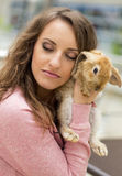 Cute teen girl with gray rabbit on Easter holiday Royalty Free Stock Photo