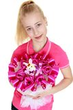 Cute teen girl holds up a bouquet of candy , close Stock Images