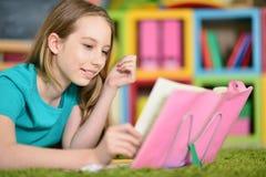 Teen girl doing homework Royalty Free Stock Photo