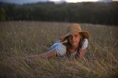 Cute teen girl lying in grass Stock Photography