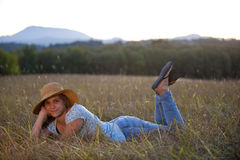 Cute teen girl lying in grass Stock Image