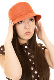 Cute teen girl model adjusting her orange hat wearing polka dot Stock Photography