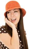 Cute teen girl model wearing orange hat and polka dot dress Royalty Free Stock Images