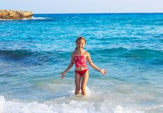 Cute Teen Girl playing In Sea Waves. Jump Accompanied By Water S. Plashes. Sunny Summer Day, Happy childhood, Ocean Coast concept Royalty Free Stock Image
