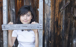 Cute teen girl posing near a house in the village. Nature. Royalty Free Stock Photography