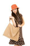 Cute teen girl with purse looking into camera wearing polka dot Stock Photography