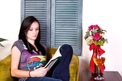 Cute Teen Girl Reading a Book Royalty Free Stock Photos