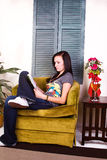Cute Teen Girl Reading a Book Stock Images
